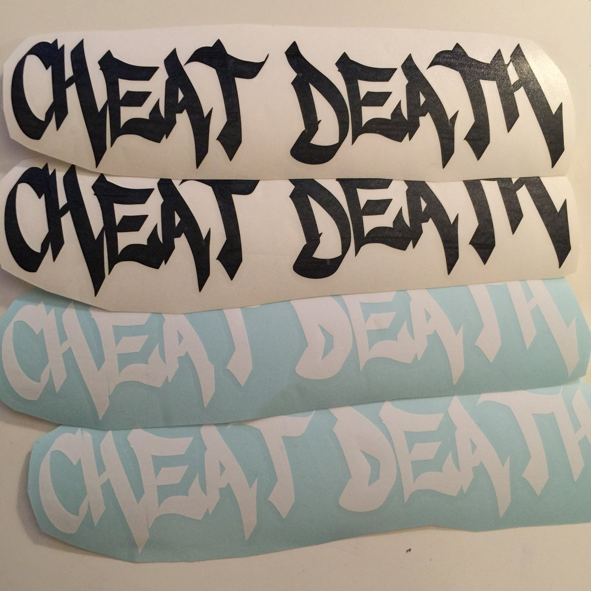 Image of Cheat Death tagger Decal