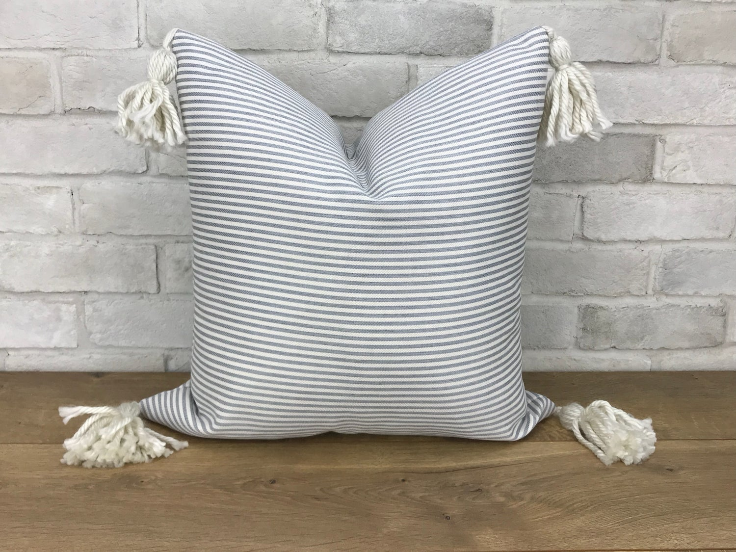 Image of Soft blue and cream stripe with cream corner tassels pillow cover