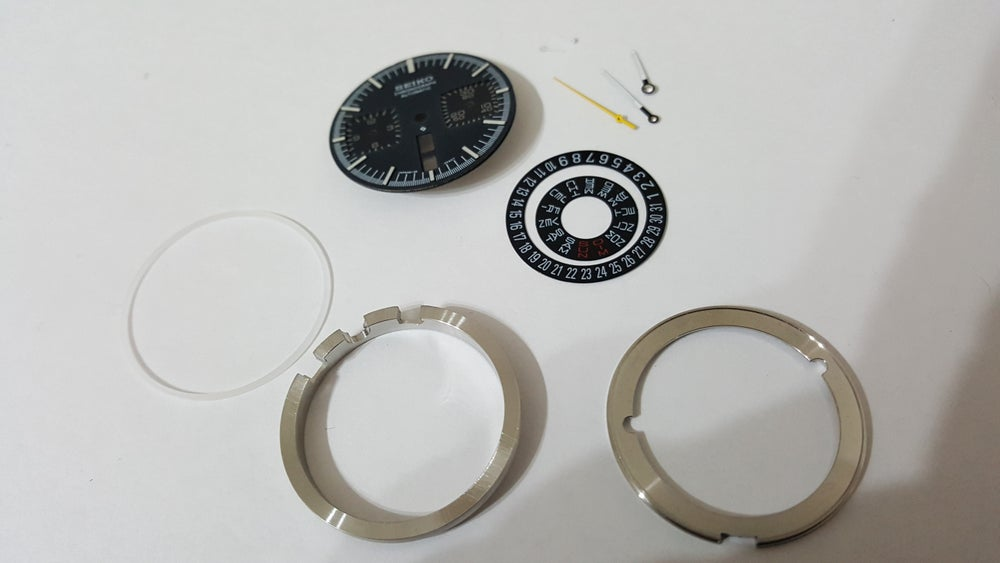 Image of NEW INTERNAL PARTS FOR SEIKO 6138-0040 BULL HEAD CHRONOGRAPH MENS WATCH,ALL BLACK DIAL.