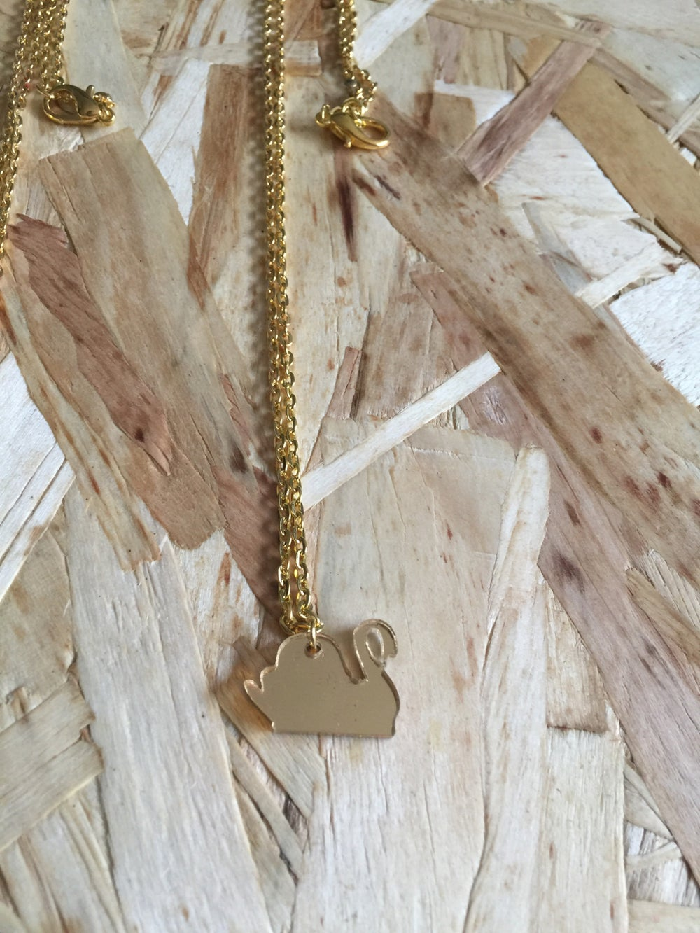 Image of LIP - Laser cut gold perspex mini swan necklace