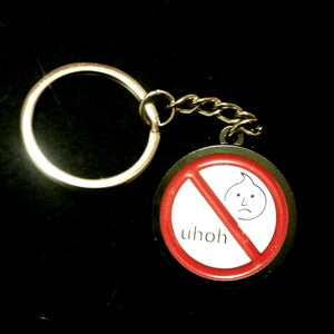 Image of UHOH Toys - Warning Keychain