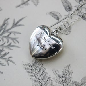 Image of hand engraved latin heart locket