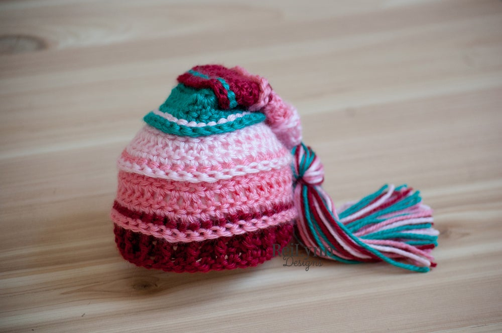 Image of Poinsettia Tassel Hat- Pink, Coral, Burgundy, and Teal