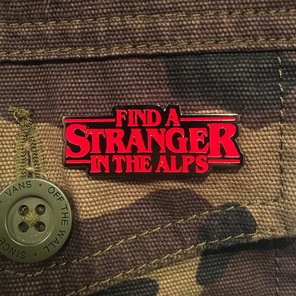 Image of Find a Stranger in the Alps Hard Enamel Pin