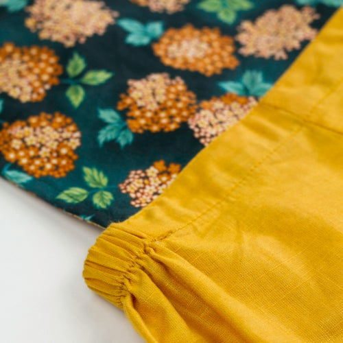 Image of Vintage Clancy Romper - Bloom Marigold