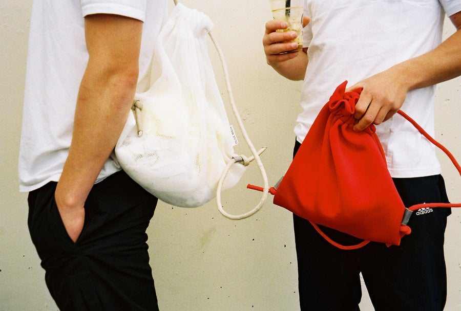 Image of Red/Red drawstring backpack.