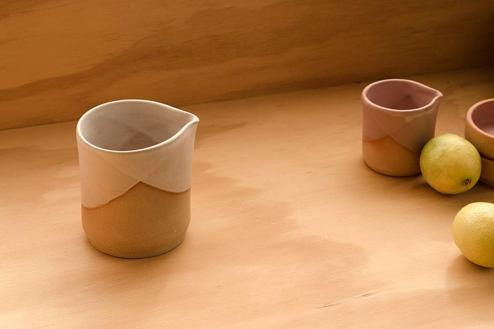 Image of Pouring Beaker (Milk)