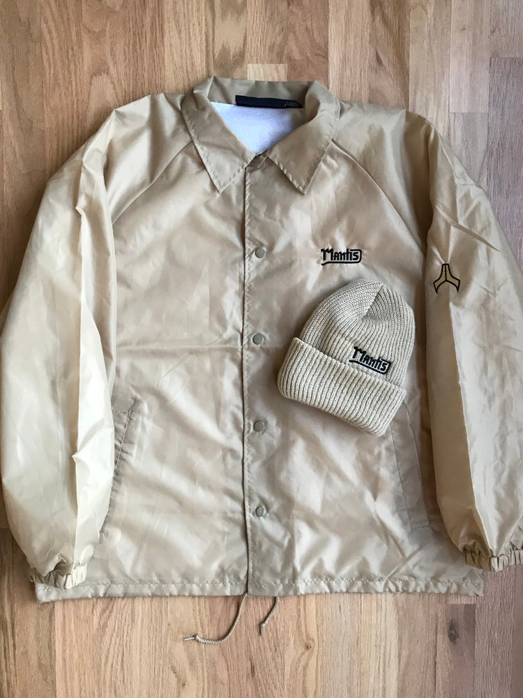 Image of Mantis Team coaches jacket tan and black snowboard jacket