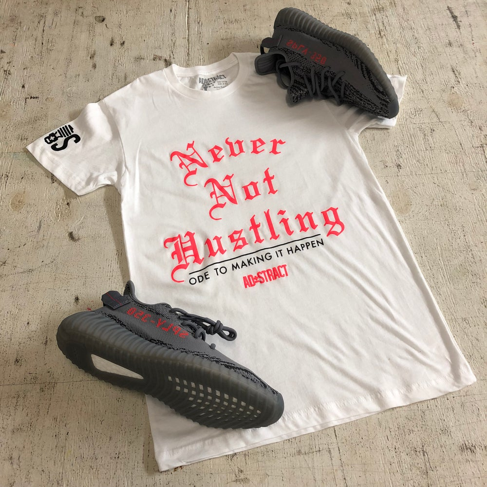"Image of NEVER NOT HUSTLING ""WHITE/BOLD ORANGE/BLACK"" OR ""BLACK/RED/WHITE"" TSHIRT"