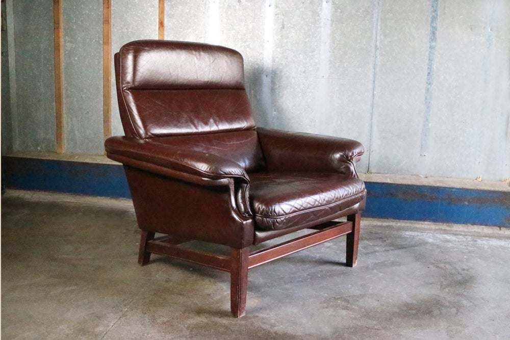 Image of 1970's mid century Danish lounge chair with original leather upholstery