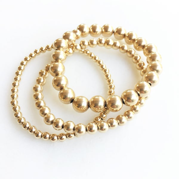 Image of TenThings. LARGE. Plain. 8mm GOLD. Beaded. Bracelet. B-GLDBD8MM