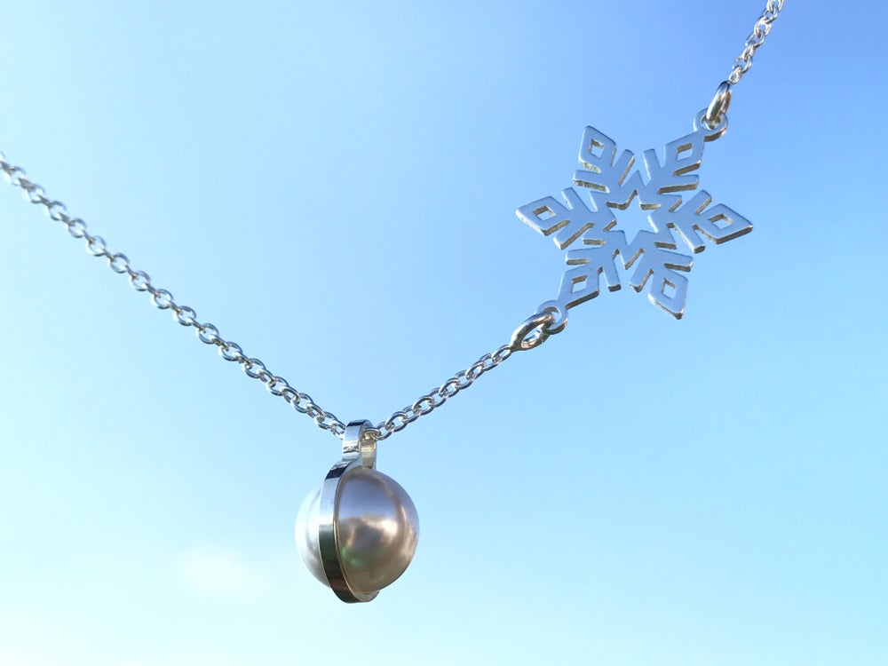 Image of Sterling silver chain, pearl and snow flake silver pendant