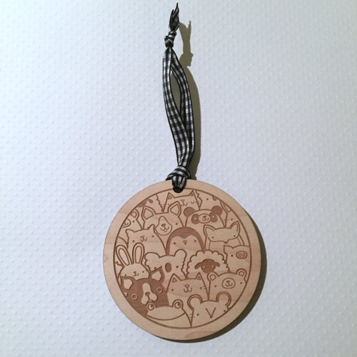 Image of laser cut maple wood ornament