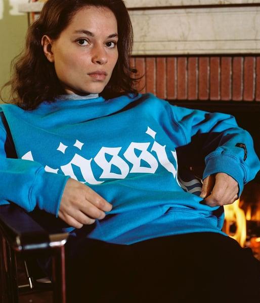 Image of big logo blue sweater