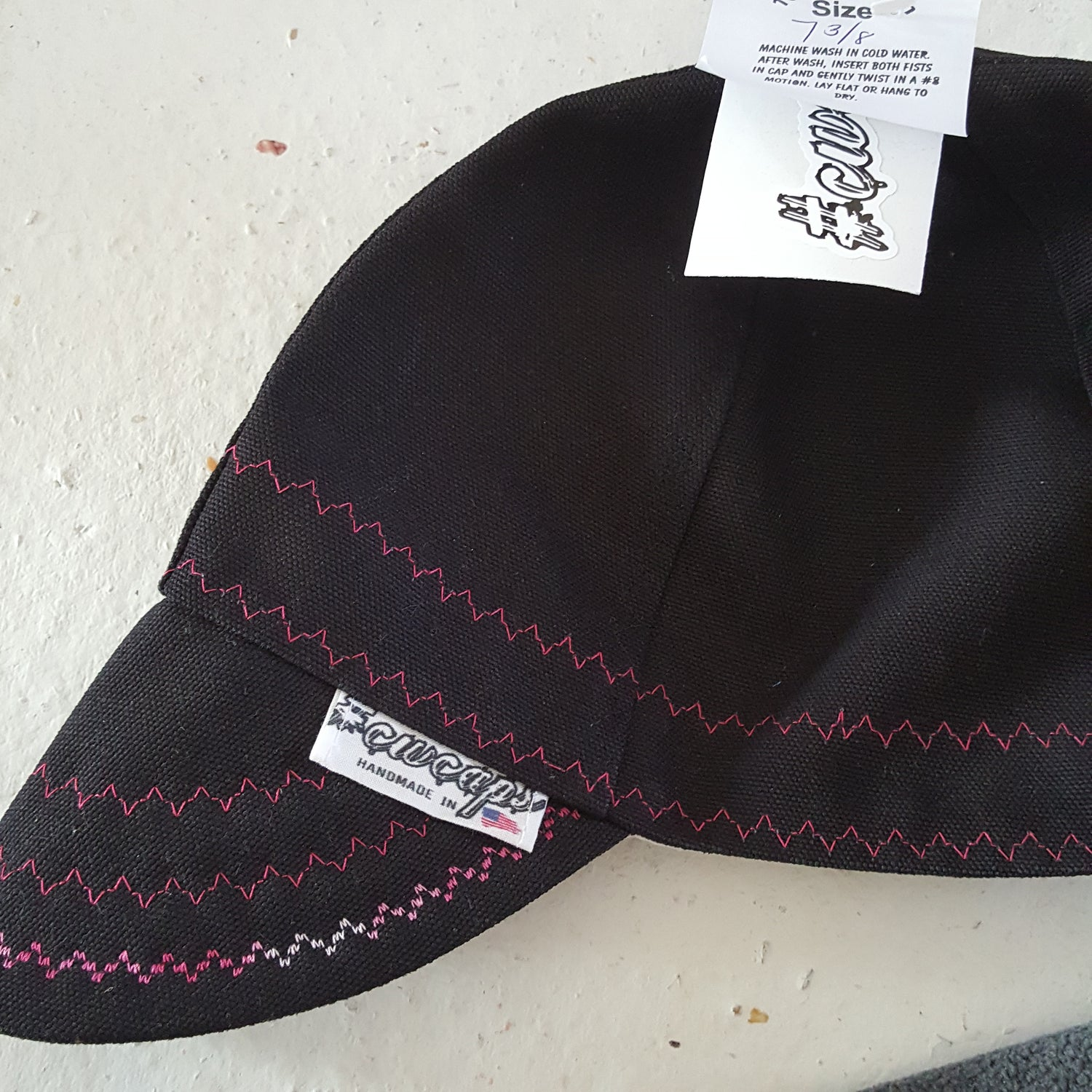 Image of SIZE 7-3/8 BLACK CARHARTT WITH PINK STITCHING