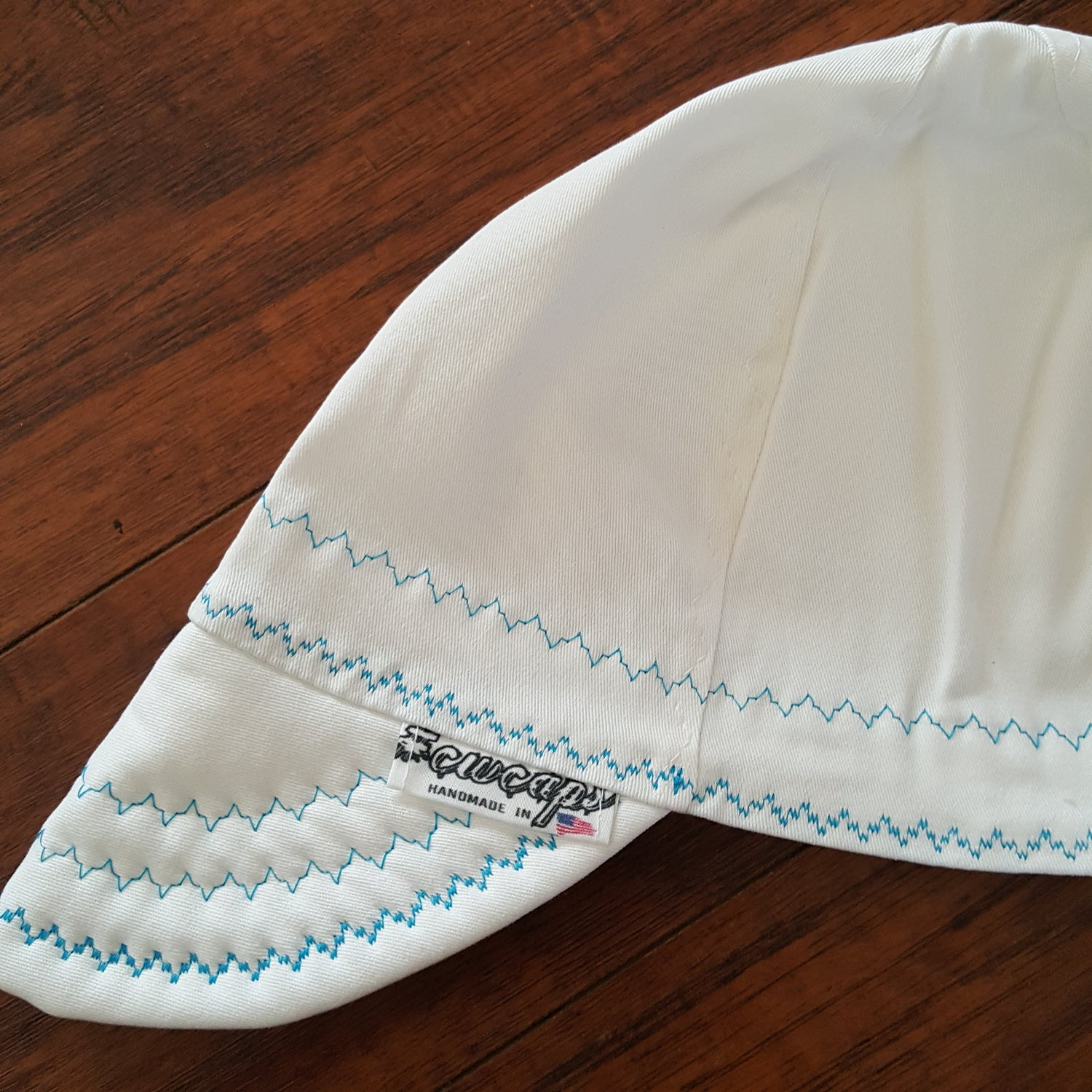 Image of SIZE 8 WHITE WELDERS CAP WITH BLUE STITCHING