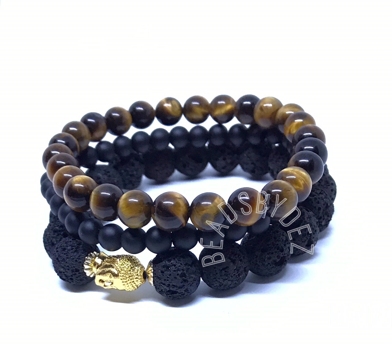 "Image of ""Courage of the man"" Stacks. One 8mm tigers eye, One 6mm onyx & One 10mm Lava stretch bracelet."
