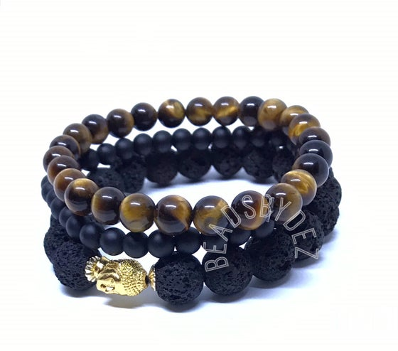 """Image of """"Courage of the man"""" Stacks. One 8mm tigers eye, One 6mm onyx & One 10mm Lava stretch bracelet."""