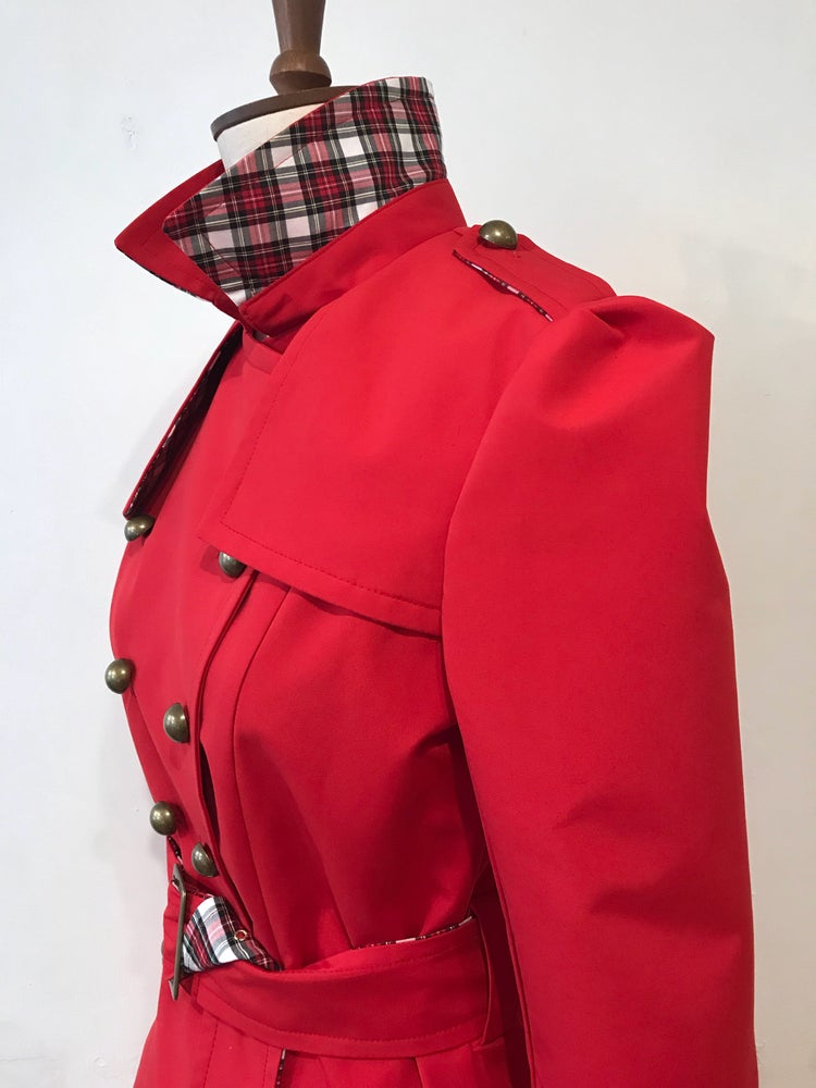 Image of Waterproof Trench coat with tartan trim.