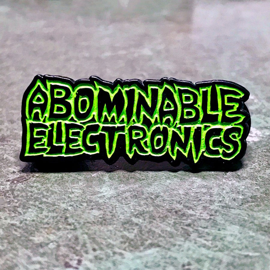 Image of Abominable Electronics GLOW Soft Enamel Pin
