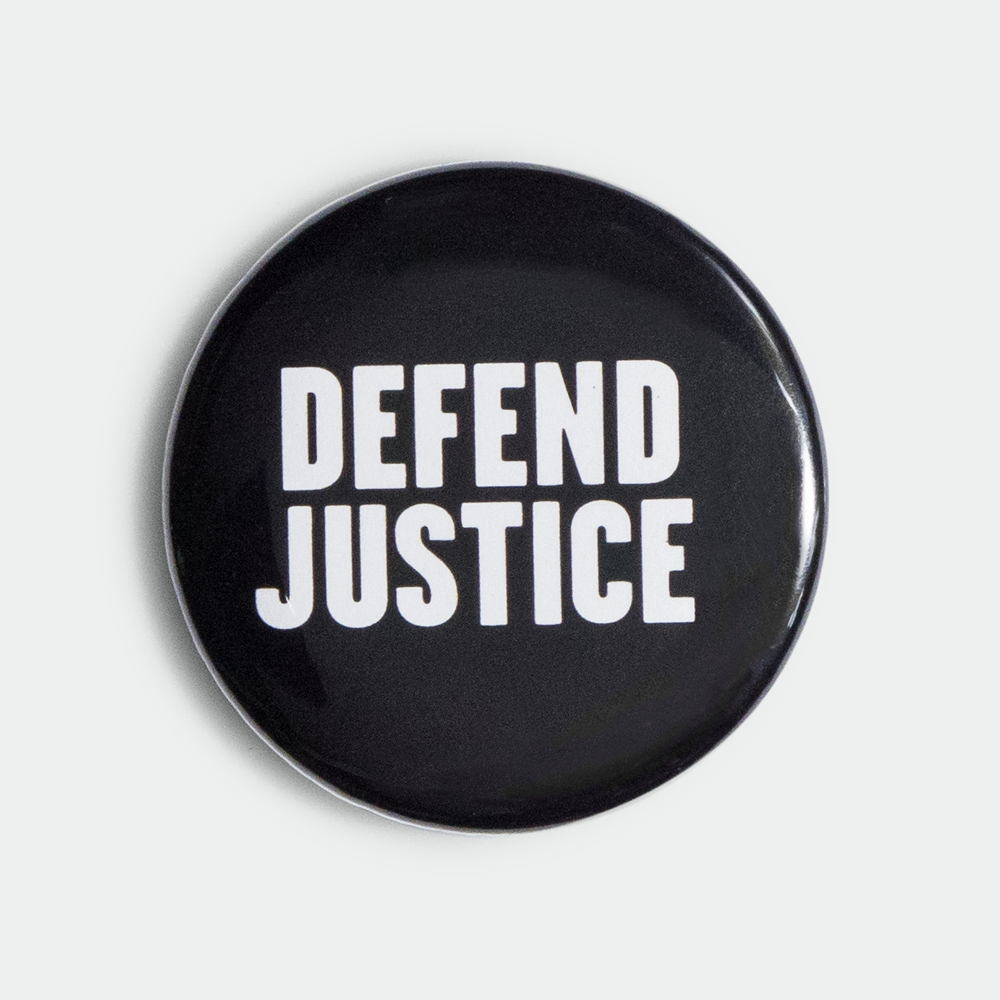 "Image of Defend Justice 1.5"" pin"