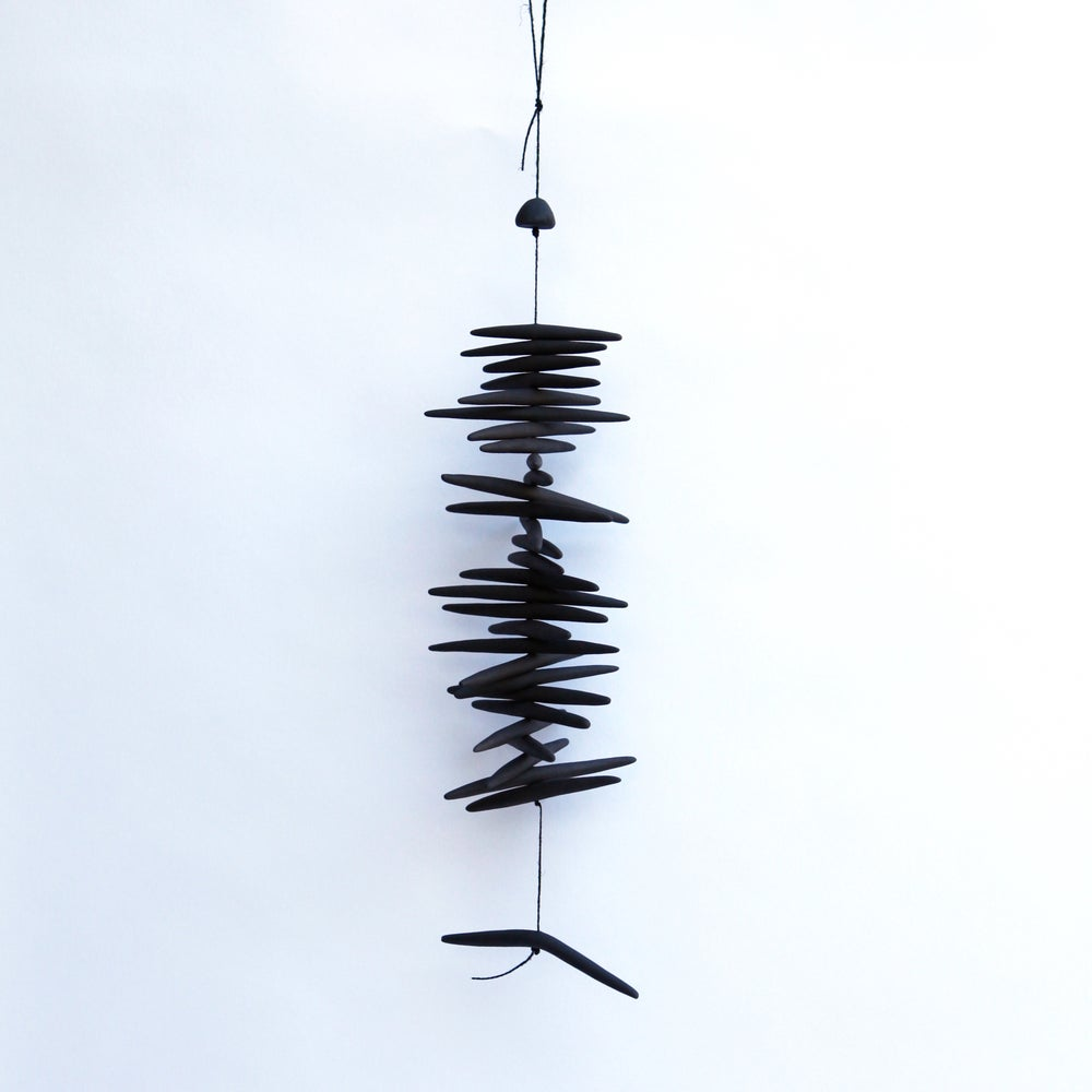 Image of Black Toothy Hanging