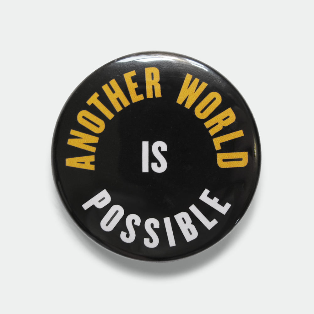 "Image of Another World is Possible 1.5"" yellow pin"