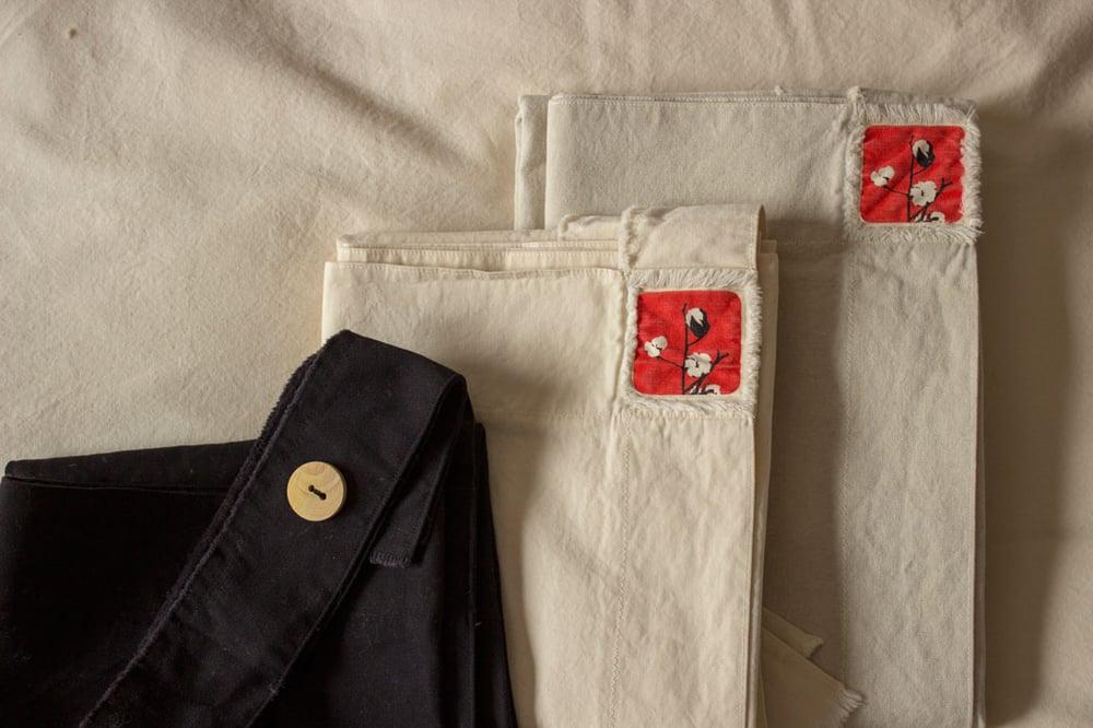 Image of Pack davantal + eixugamà / Pack delantal + paño cocina