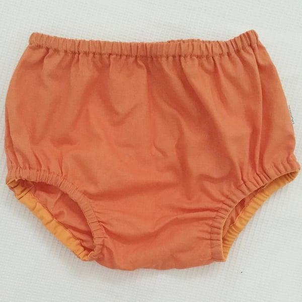 Image of Bright orange nappy pants