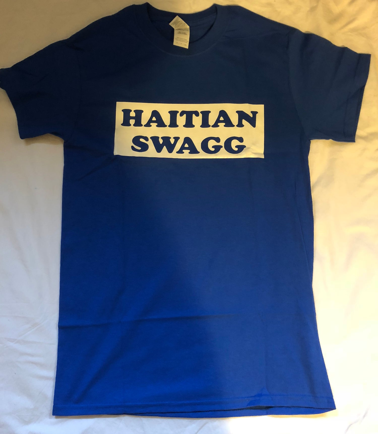 Image of Haitian Swagg blue and white , Blue tee