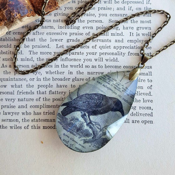 Image of Raven Antique Book Page Pendant Necklace