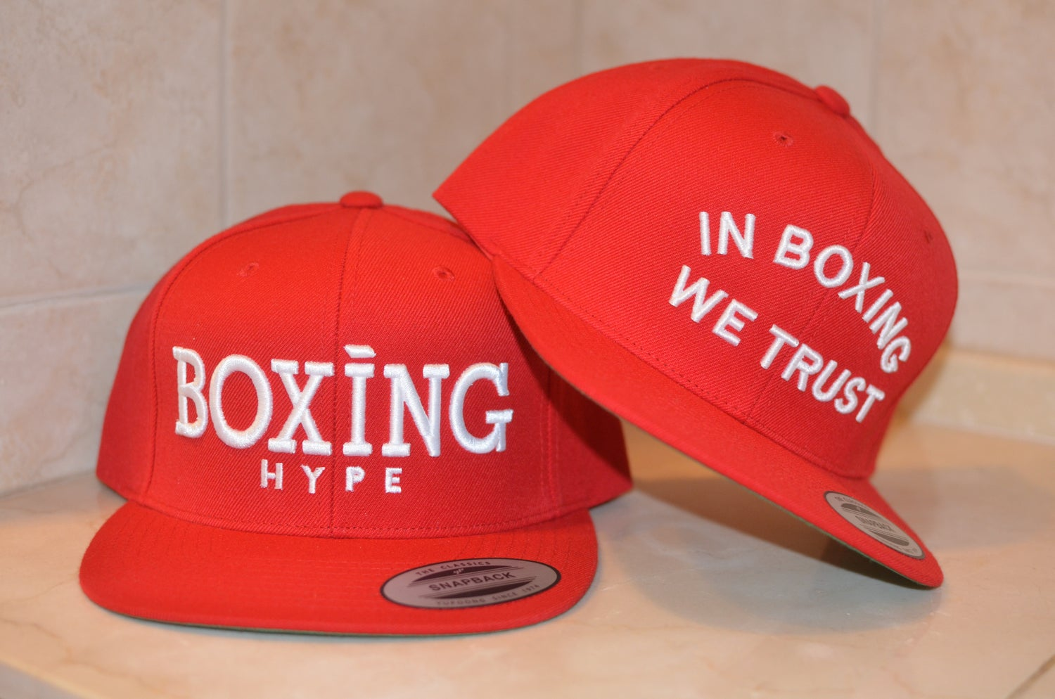 Image of red on white classic BH snapbacks