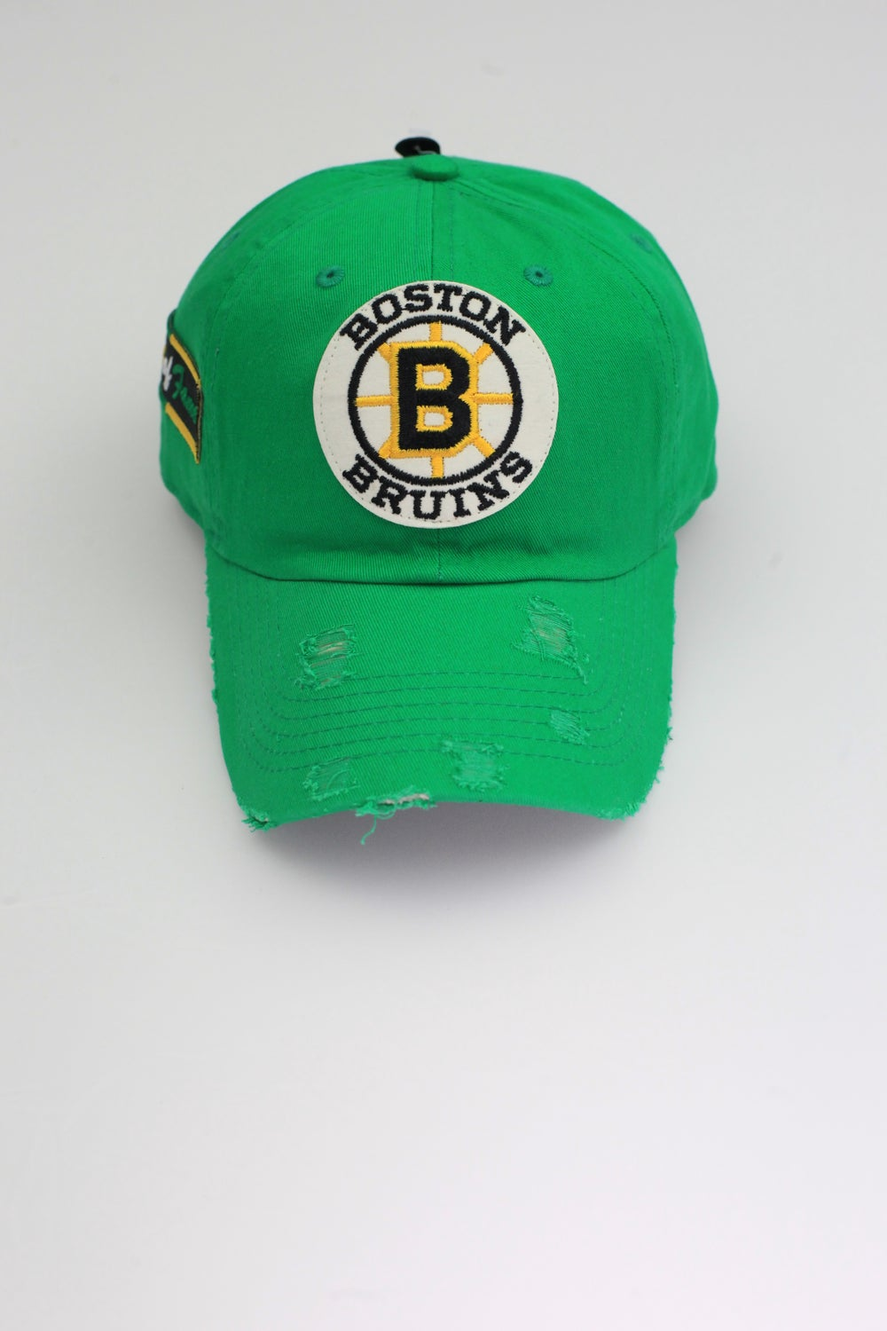 Image of Bruins Kelly Green Distressed Dad Hat