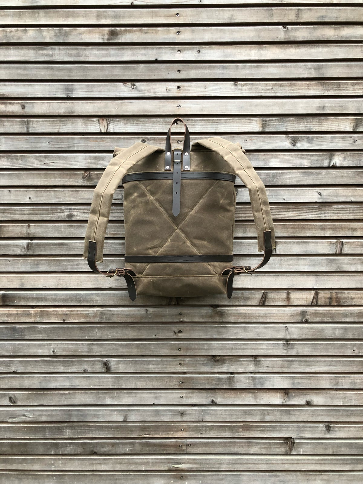 Image of Waxed canvas backpack - rucksack with folded top and waxed canvas padded shoulder straps