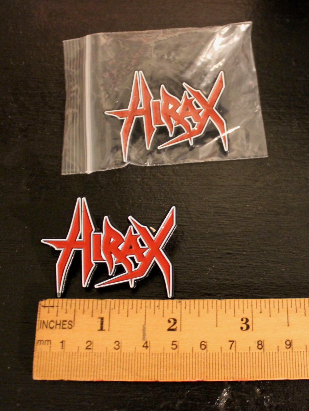 HIRAX metal pin/badge