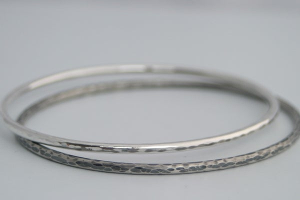 Image of Hammered silver bangles