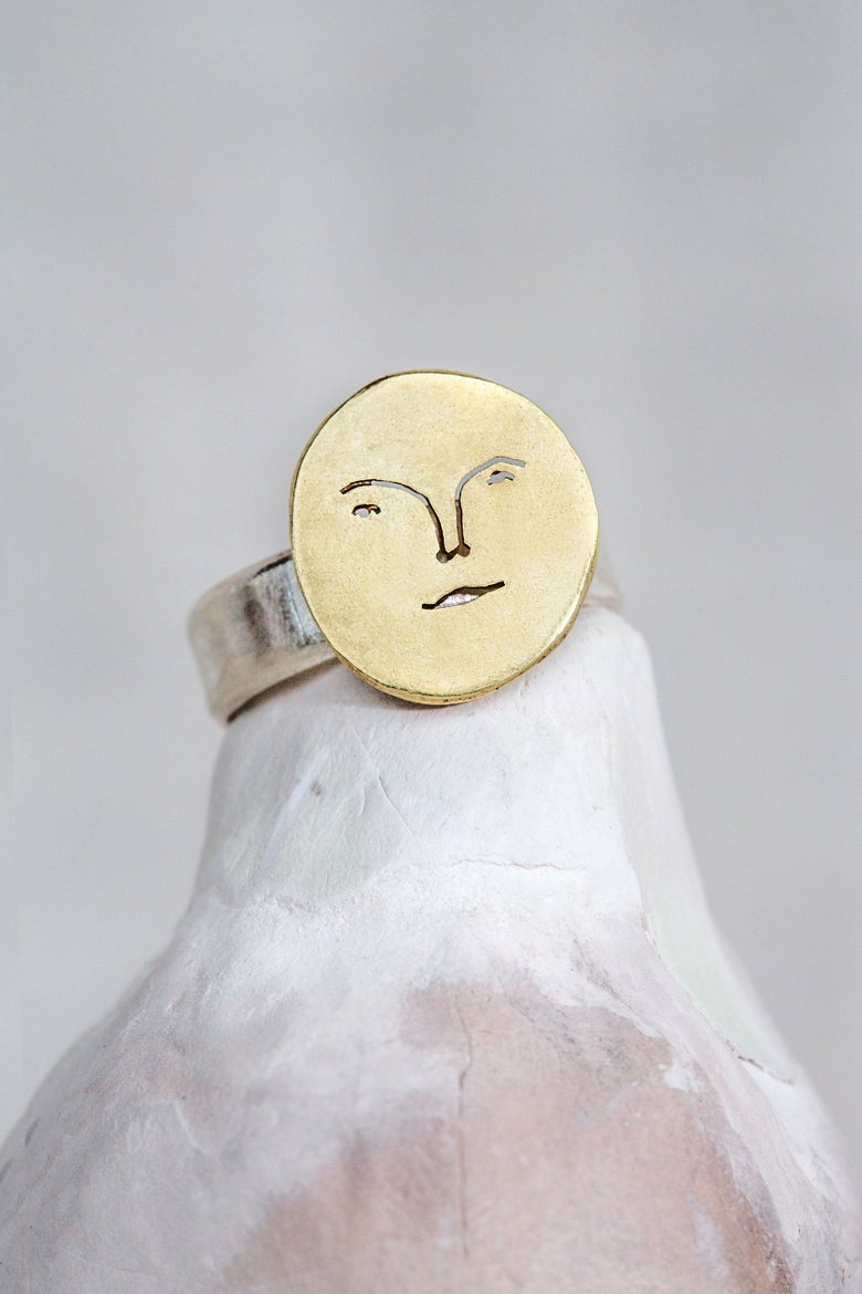 Image of brass sun face ring