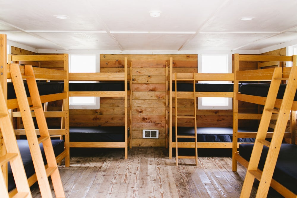 Image of 1 camp bunk with bed + bath linens included for entire weekend