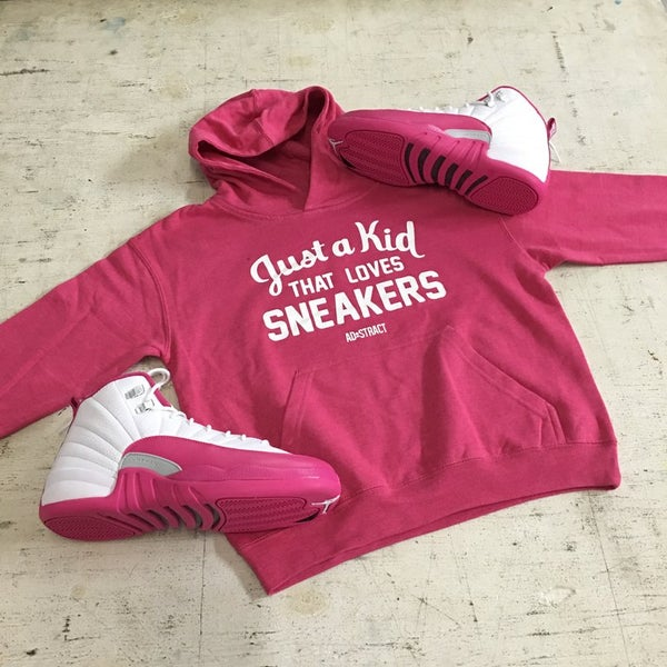 "Image of JUST A KID THAT LOVES SNEAKERS FLEECE HOODY ""WHITE PRINT"" (YOUTH)"