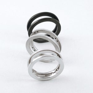 Image of INFINITY FOLDING RING — BLACK / SILVER