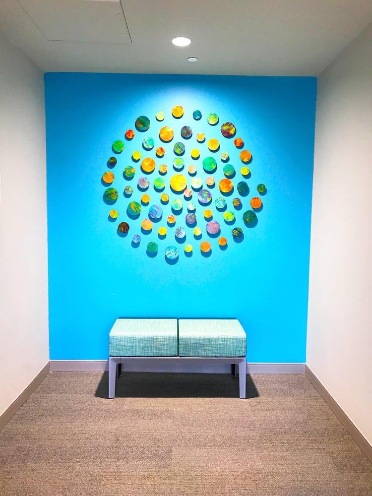 Image of 'KINETIC SUNSHINE' | Circle Wall Art | Modern Installation Art | Wood Wall Sculpture | Public Art