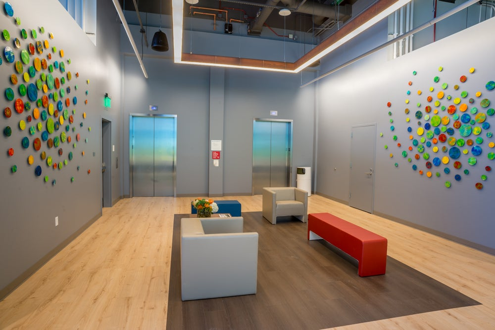 Image of 'KINETIC SUNSHINE' | Art Installation | Large Wall Art | Wood Wall Art | Corporate Lobby Art