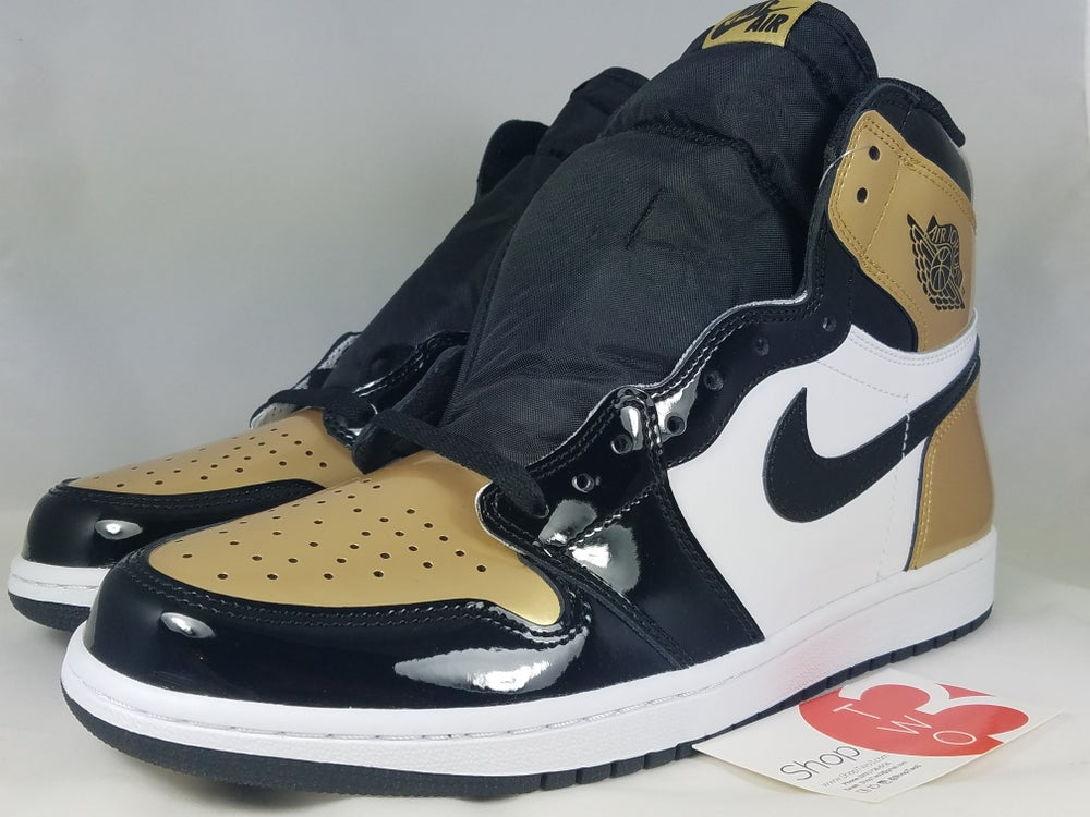 Image of Jordan 1 Retro High NRG Patent Gold Toe