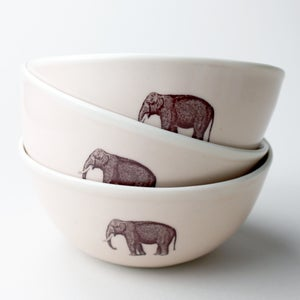 Image of rustic bowl with elephant, rose