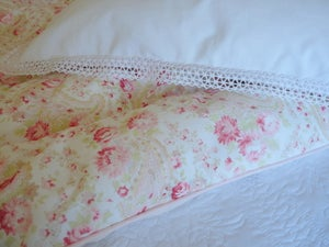 "Image of Beautiful ""rhubarb"" paisley eiderdown in Sarah Hardaker fabric"