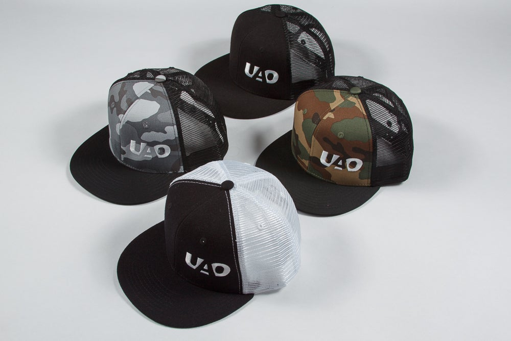Image of UAO Clothing Co. Embroidered LM Logo Trucker Hat (Black, Black/White, Camo, DigiCamo)