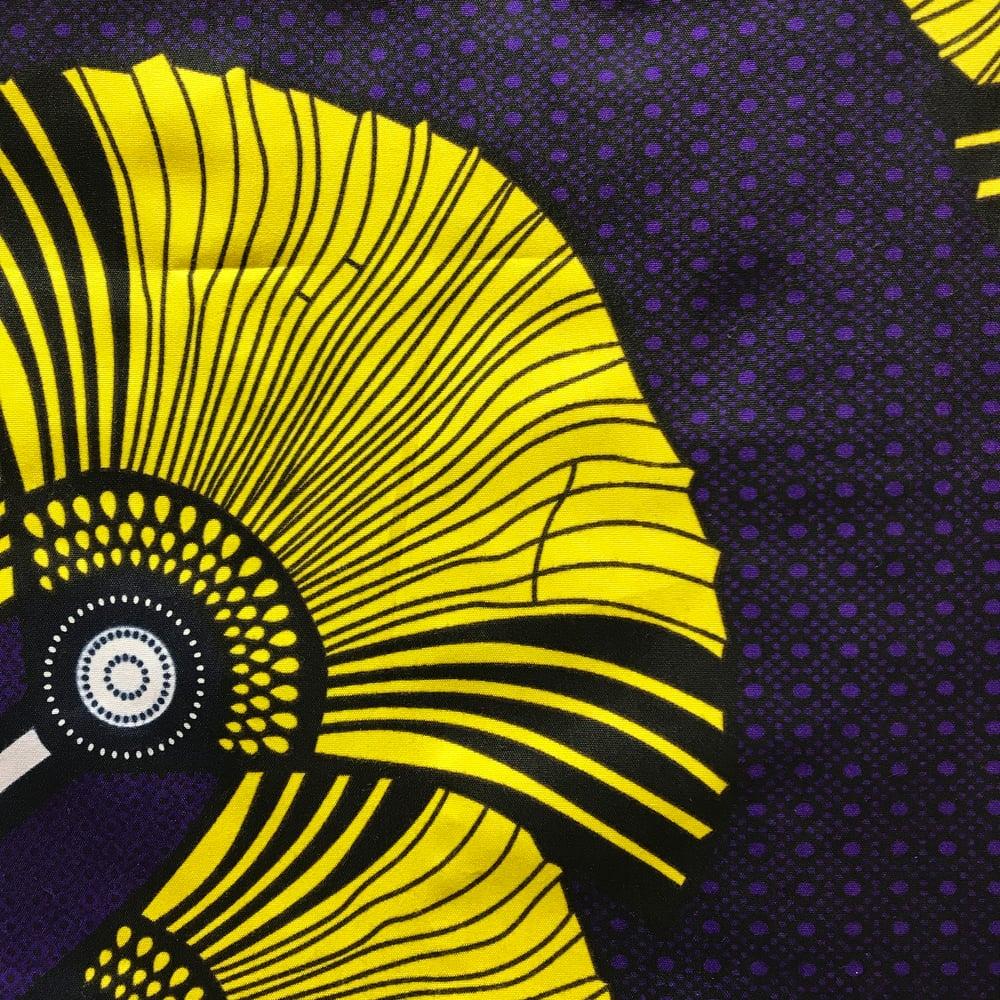 Image of Unisex termojakke i lilla med store gule blomster (s)