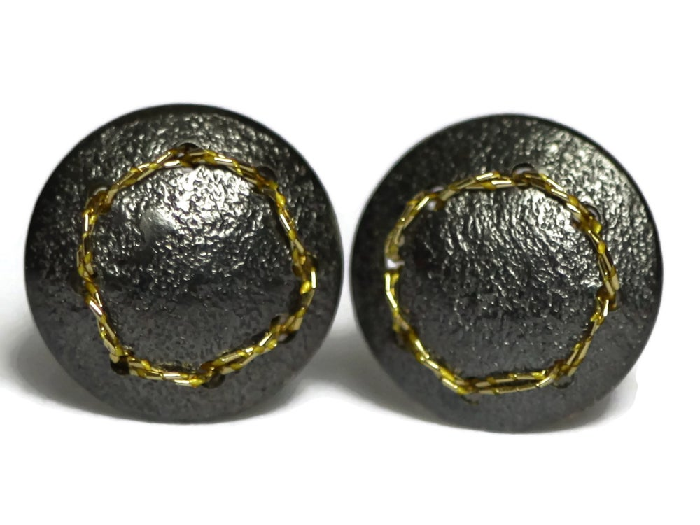 Image of Sewn Up earrings with a sewn circle