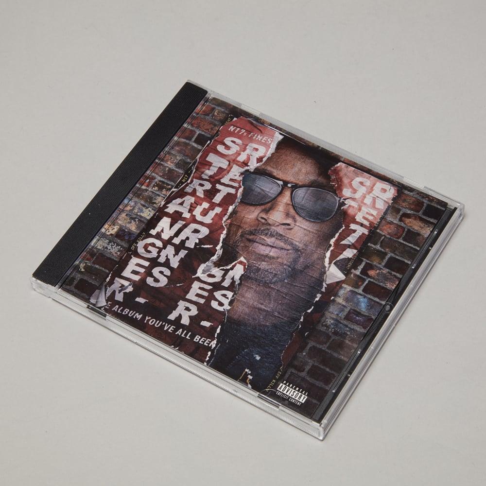 Image of STRANGER RETURNS ALBUM | DELUXE PACKAGE | CD | T SHIRT | POSTER