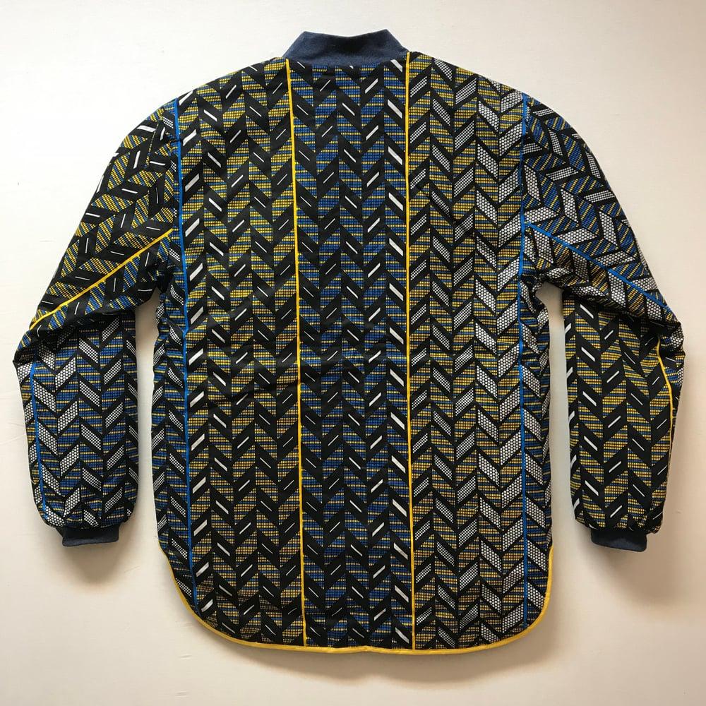 Image of Unisex termojakke med blå/gul/sort sildebens print (l)